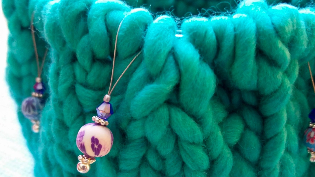 chunky yarn with stitch markers on circular needles