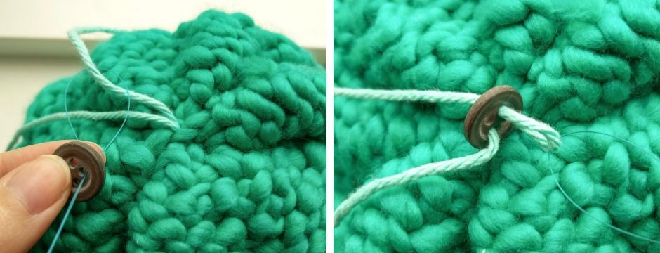 Pulling yarn through the holes in a button
