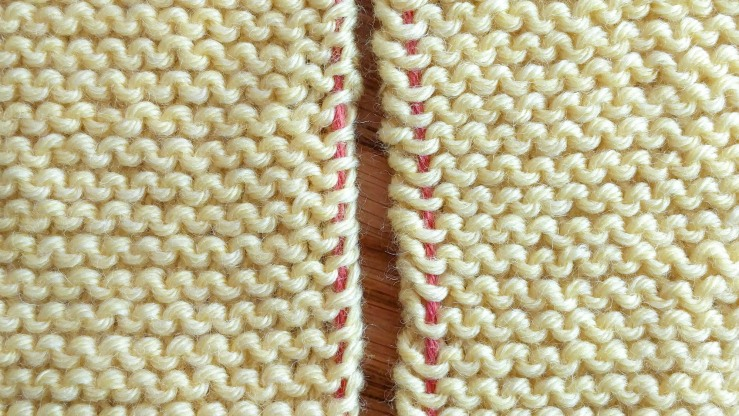 Garter stitch with the stitches marked by contrast yarn that will be used for seaming